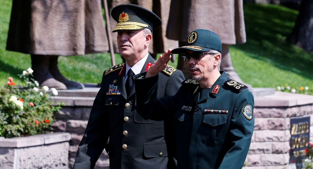 Turkish Chief of Staff General Hulusi Akar and his Iranian counterpart Major General Mohammad Baqeri review the guards of honour during a welcoming ceremony in Ankara, Turkey, August 15, 2017