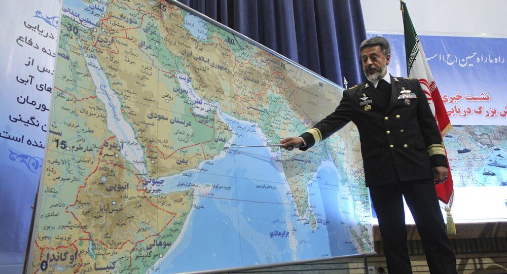 Iran's navy chief Adm. Habibollah Sayyari briefs media on an upcoming naval exercise, in a press conference in Tehran, Iran, Thursday, Dec. 22, 2011
