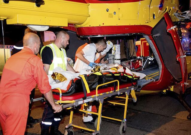 This photo provided Tuesday Aug. 15 2017 shows rescue workers evacuating a victim in a helicopter after a man deliberately rammed his car into a pizzeria in Sept-Sorts, east of Paris, Monday Aug. 14, 2017.