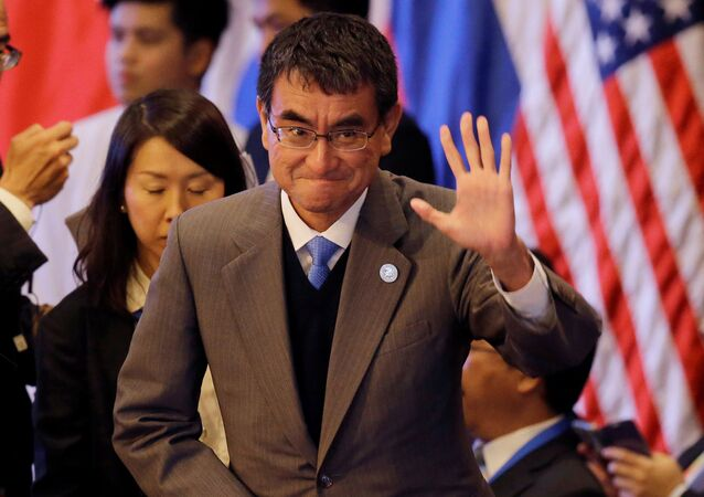 Japanese Foreign Minister Taro Kono waves at the start of the 7th East Asia Summit Foreign Ministers' Meeting and its dialogue partners as part of the 50th ASEAN Ministerial Meetings in Manila, Philippines August 7, 2017
