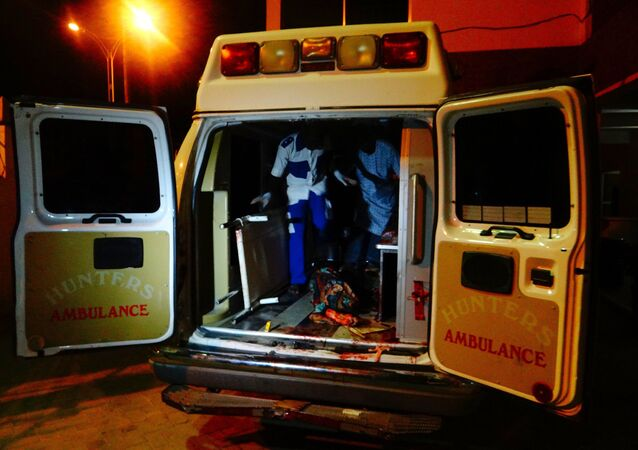 An injured victim of a female suicide bomber arrives in an ambulance for medical attention at a Maiduguri hospital in northeast Nigeria on August 15, 2017