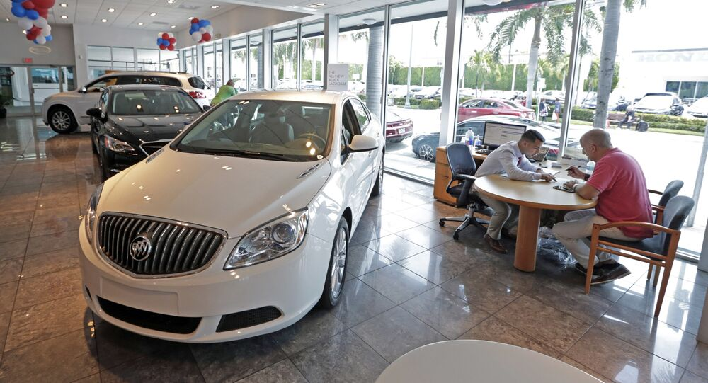 In this Wednesday, April 26, 2017, photo, client specialist Felipe A. Perdomo, left, closes a deal with customer John Tsialas at a GMC Buick dealership in Miam
