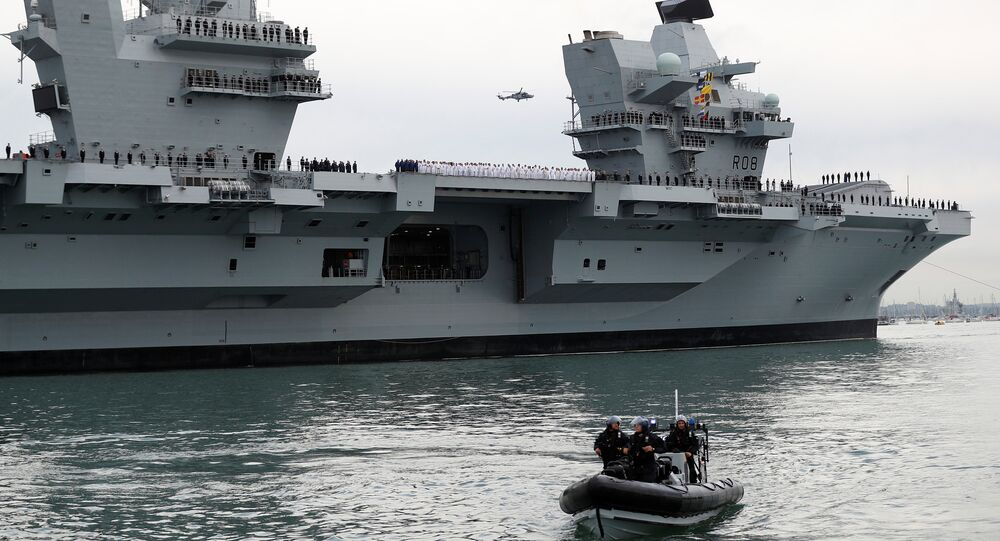 The Royal Navy's new aircraft carrier HMS Queen Elizabeth arrives in Portsmouth, Britain, 16 August 2017