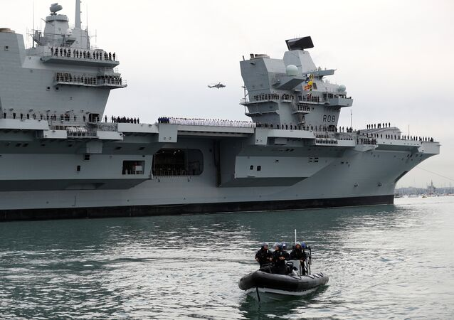 The Royal Navy's new aircraft carrier HMS Queen Elizabeth arrives in Portsmouth, UK, 16 August 2017