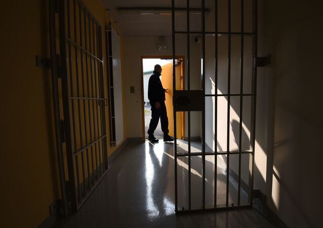 A prison guard open a door during a press visit on October 14, 2015 in the new prison in Valence, southeastern France