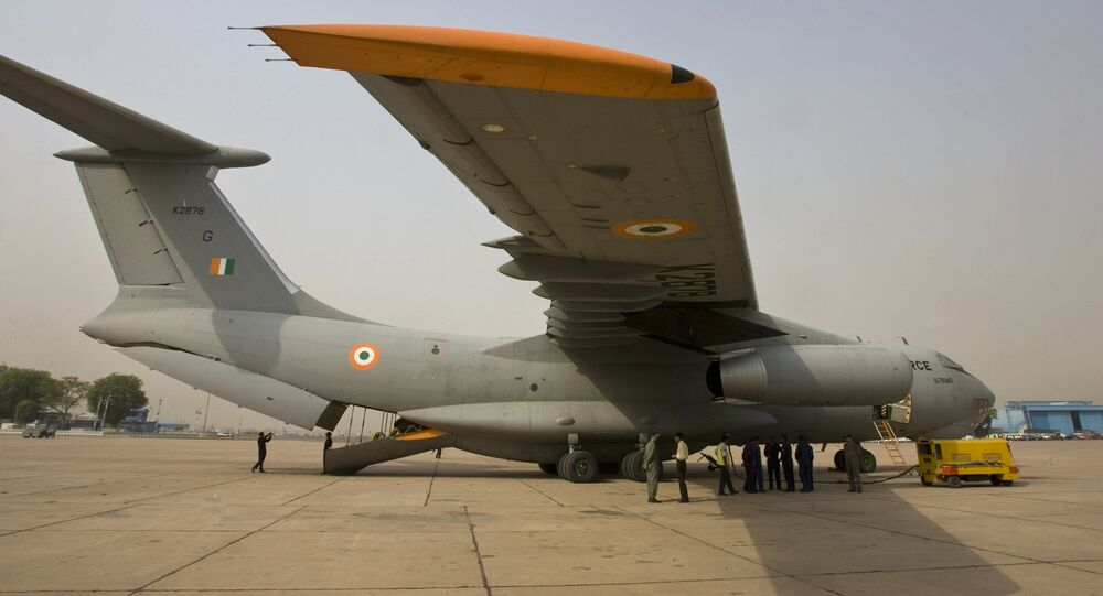 Indian Air Force personnel stand near an IL 76 aircraft as they prepare for departure with relief materials, including tents, blankets and medicines, for cyclone-affected Myanmar, at the airport in New Delhi, India, Thursday, May 8, 2008