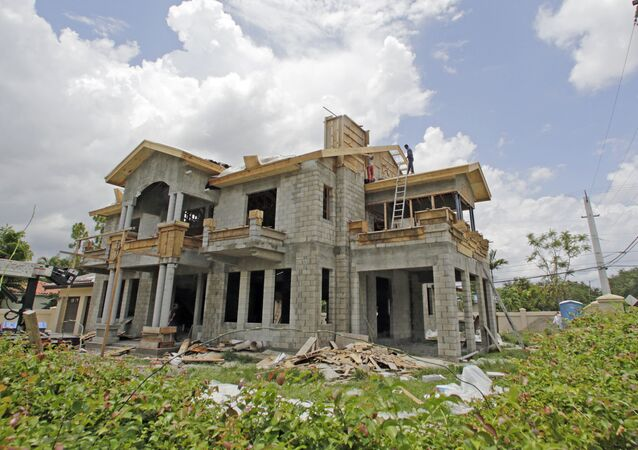 This Thursday, June 8, 2017, photo shows a new home under construction, in Miami Springs, Fla.