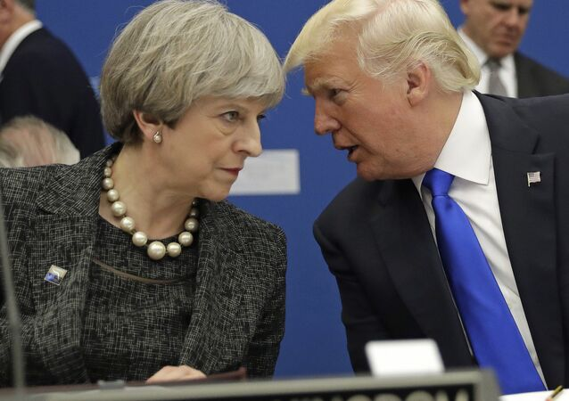 British Prime Minister Theresa May, left, speaks to U.S. President Donald Trump during a working dinner meeting at the NATO headquarters during a NATO summit of heads of state and government in Brussels on Thursday, May 25, 2017.
