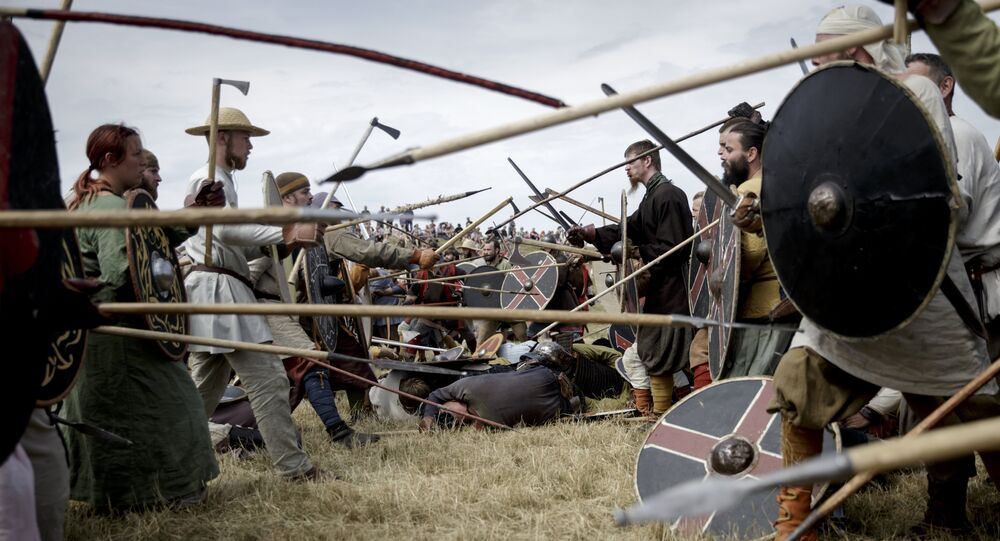 Around 200 people dressed as Vikings simulate a battle during the Viking Festival at Trelleborg, the Viking fortress of King Harald Bluetooth from around year 980 ad, near Slagelse, south-west of Copenhagen, on Friday July 17, 2015