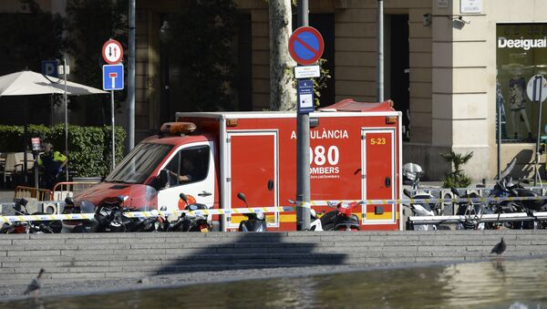 A policeman stands next to an ambulance after a van ploughed into the crowd, injuring several persons on the Rambla in Barcelona on August 17, 2017 - Sputnik International