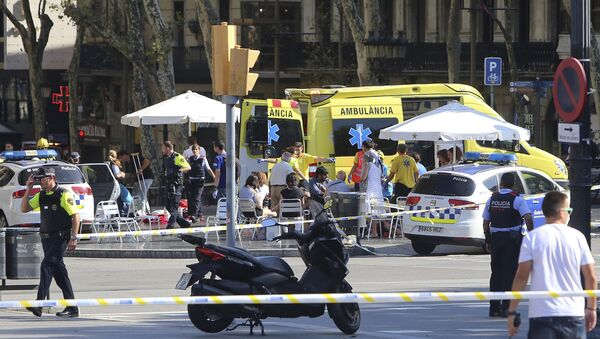 Injured people are treated in Barcelona, Spain, Thursday, Aug. 17, 2017 after a white van jumped the sidewalk in the historic Las Ramblas district, crashing into a summer crowd of residents and tourists and injuring several people, police said - Sputnik International