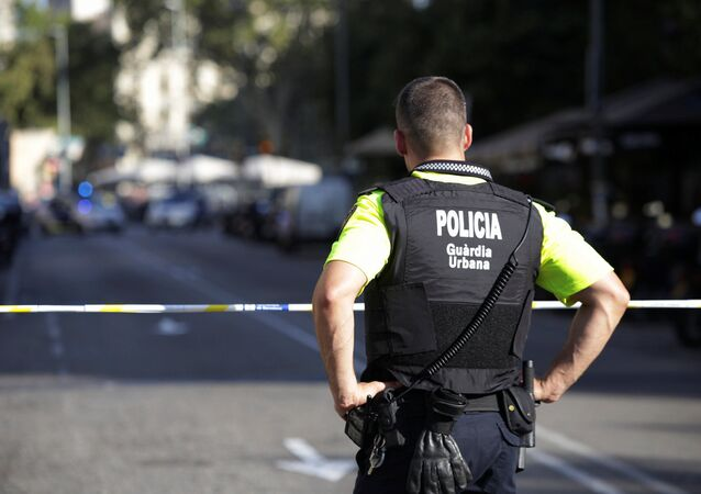 A police officer stands by a cordoned off street after a van crashed into pedestrians near the Las Ramblas avenue in central Barcelona, Spain, August 17, 2017