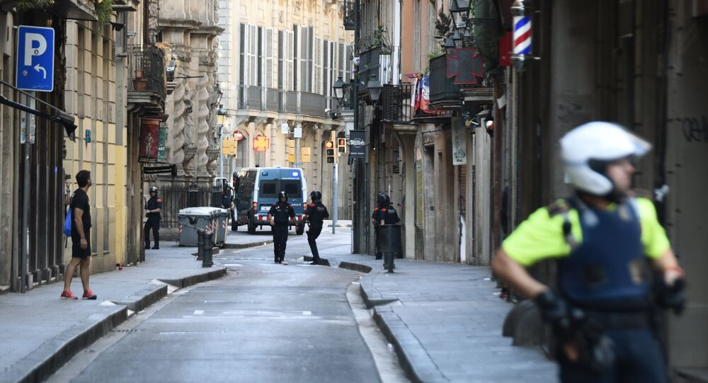 Police secure the area close to the scene after a white van jumped the sidewalk in the historic Las Ramblas district of Barcelona, Spain, crashing into a summer crowd of residents and tourists Thursday, Aug. 17, 2017.