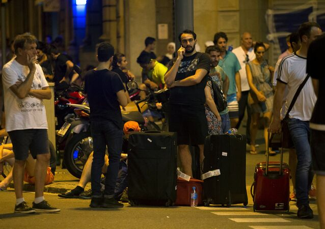 People wait to enter the area after a van crashed into pedestrians near the Las Ramblas avenue in central Barcelona, Spain August 17, 2017