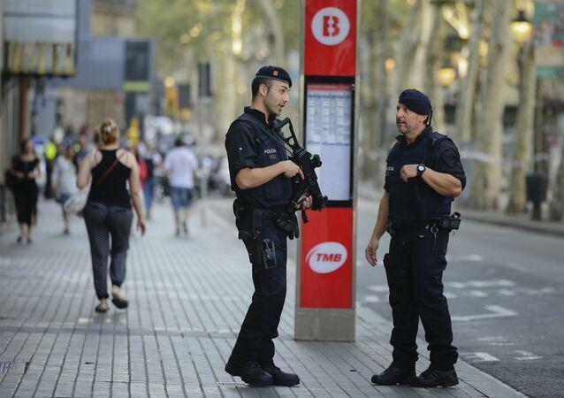 Armed police officers patrol a street in Las Ramblas, Barcelona, Spain, Friday, Aug. 18, 2017