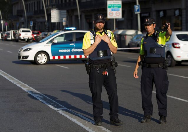 Police cordon off the area after a van crashed into pedestrians near the Las Ramblas avenue in central Barcelona, Spain August 17, 2017