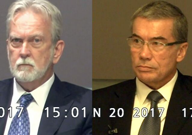 These undated still photos from trial deposition video, accepted as evidence in court and provided by the American Civil Liberties Union, shows psychologists James Mitchell, left, and John Jessen, defendants in a landmark lawsuit that the ACLU filed against the creators of the CIA's harsh interrogation program used in the war on terror.