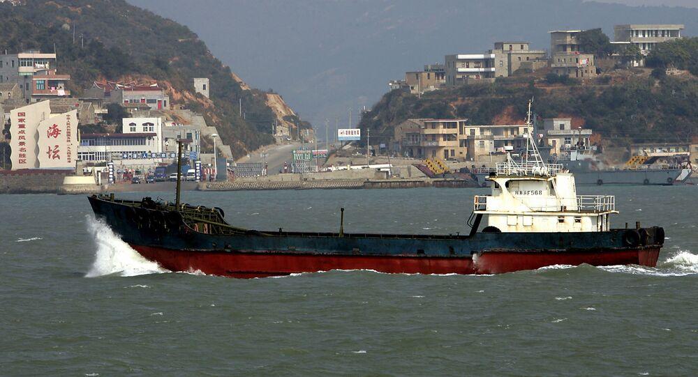 A ship steams by the main ferry terminus on Pingtan island