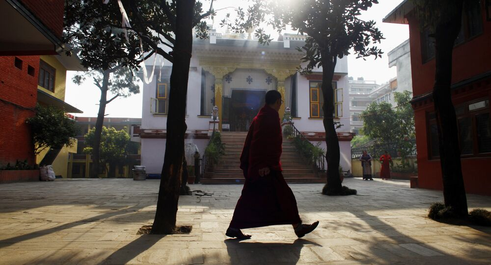 A Tibetan monk walks inside a deserted Tibetan Monastery at Boudhanath Stupa in Katmandu, Nepal. (File)
