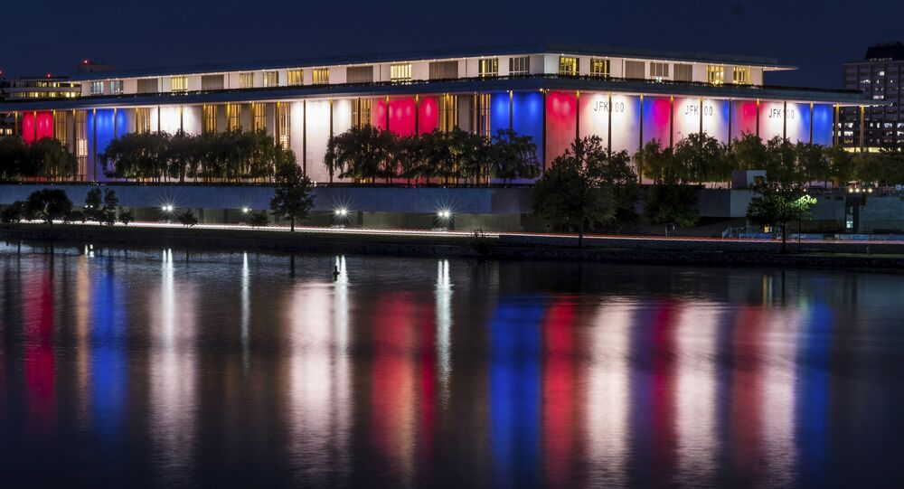 The red, white and blue lights, marking the 100th birthday of President John F. Kennedy, on the outside of the Kennedy Center for the Performing Arts are reflected in the Potomac River in Washington, Friday, May 26, 2017.
