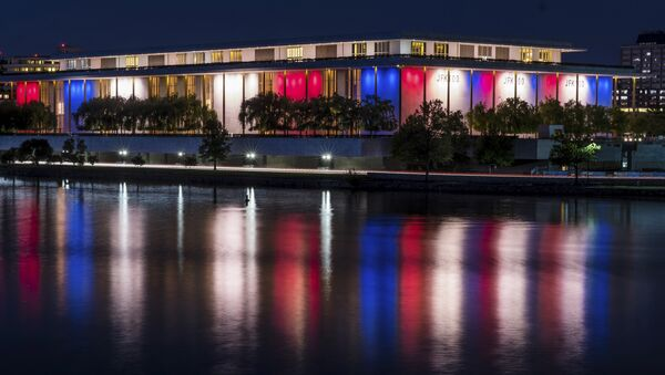 The red, white and blue lights, marking the 100th birthday of President John F. Kennedy, on the outside of the Kennedy Center for the Performing Arts are reflected in the Potomac River in Washington, Friday, May 26, 2017. - Sputnik International