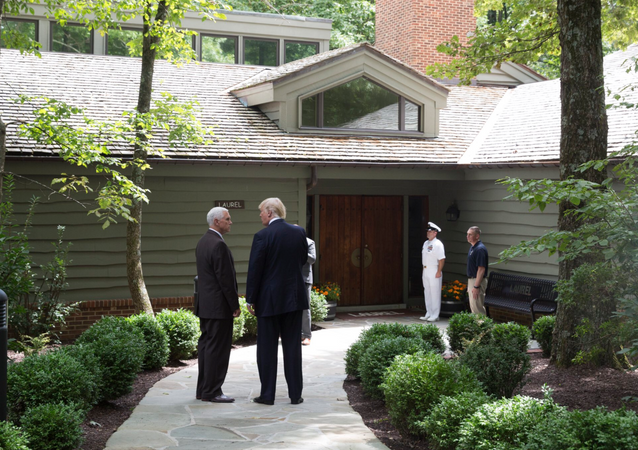 US President Donald Trump speaks with VP Mike Pence at Camp David, Maryland on August 19, 2017.