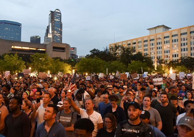 People attend a Dallas Against White Supremacy rally at City Hall Plaza in Dallas, Texas, U.S. August 19, 2017.