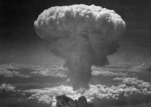 In this photo provided by the U.S. Air Force, a giant column of dark smoke rises more than 20,000 feet into the air, after the second atomic bomb ever used in warfare explodes over the Japanese port and town of Nagasaki, on August 9, 1945.