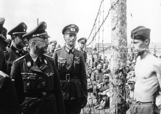 This undated photograph shows the Head of the Nazi German SS and Gestapo, Heinrich Himmler, as he inspects a German prisoner of war camp at an unknown location in the Soviet Union.
