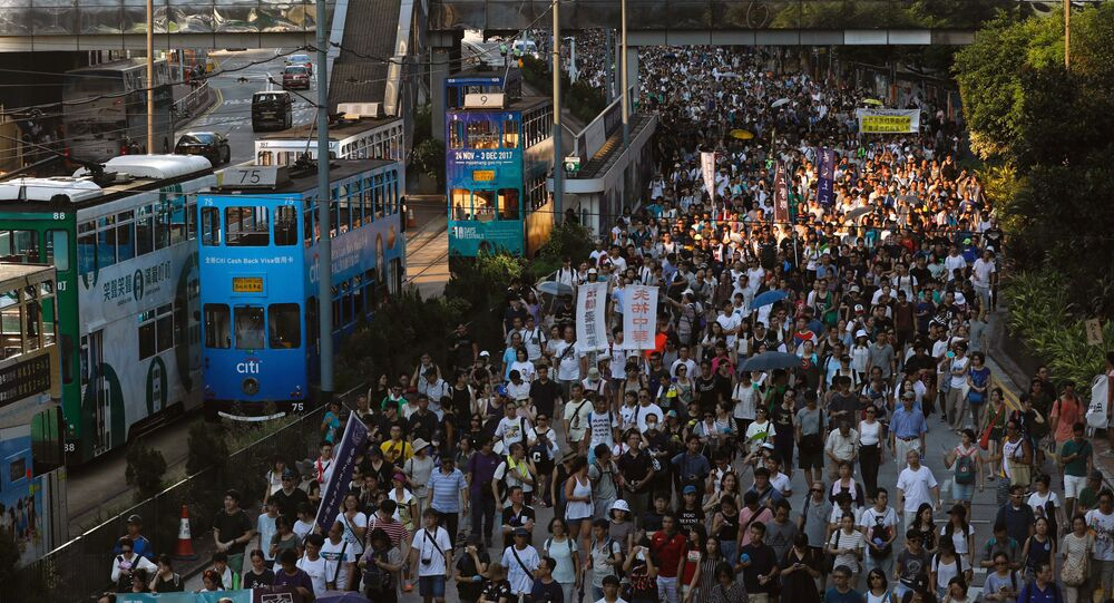 Demonstrators march in protest of the jailing of student leaders Joshua Wong, Nathan Law and Alex Chow, who were imprisoned for their participation of the 2014 pro-democracy Umbrella Movement, also known as Occupy Central protests, in Hong Kong China August 20, 2017