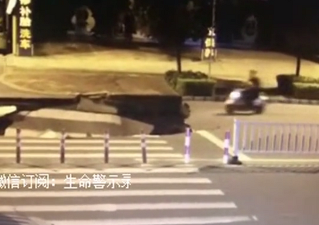Sinkhole Eats Up Distracted Driver in China