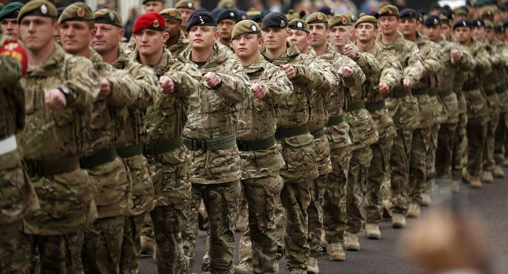 Members of the British military's 4th Mechanised Brigade parade through central London to attend a reception at the Houses of Parliament, Monday, April 22, 2013. The soldiers recently returned from six months serving in Afghanistan's Helmand province.