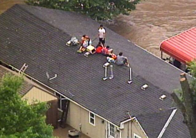Rains Flood Kansas City Streets, Residents Stuck On Rooftops