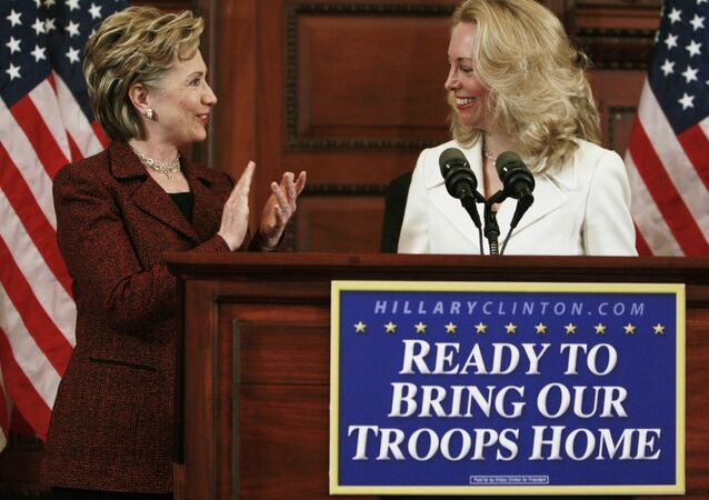 Democratic presidential hopeful, Sen. Hillary Rodham Clinton, D-N.Y., left, applauds former CIA officer Valerie Plame, right, as she speaks, prior to Clinton speaking about Iraq, Tuesday, March 18, 2008, in Philadelphia.