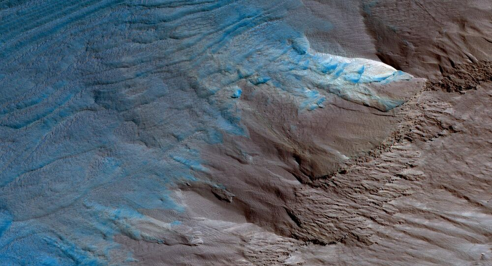 This image, an oblique view from NASA's Mars Reconnaissance Orbiter of the sloping edge of the stack of icy layers over the South Pole