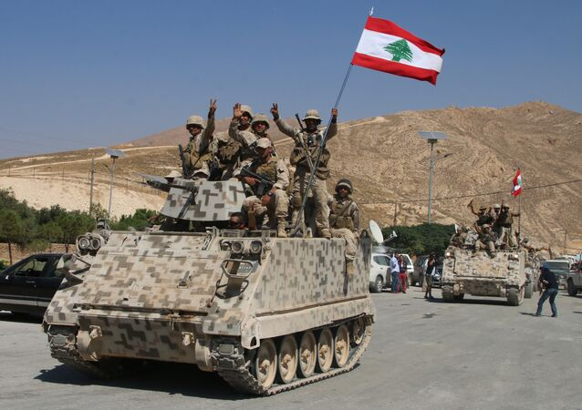 Lebanese army soldiers sit a top an armoured personnel carrier (APC) as they drive in the eastern town of Ras Baalbek, on August 21, 2017, upon returning from the mountainous frontline where an offensive against the Islamic State group on the country's eastern border with Syria after capturing a third of the territory IS held in the region.