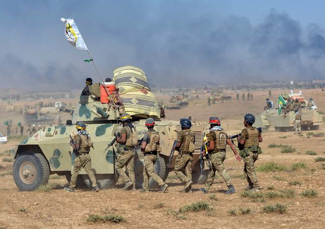 Shi'ite Popular Mobilization Forces (PMF) gather with Iraqi army on the outskirts of Tal Afar, Iraq, August 22, 2017