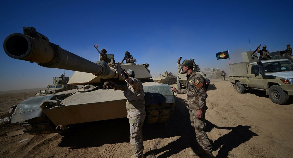 Shi'ite Popular Mobilization Forces (PMF) with Iraqi army are seen on the outskirts of Tal afar, Iraq, August 20, 2017