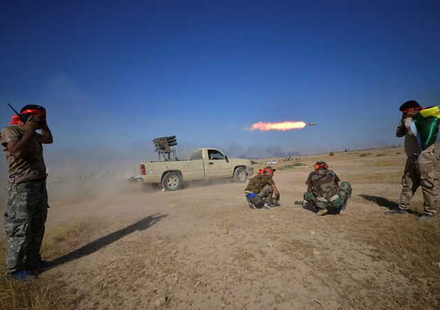 Shi'ite Popular Mobilization Forces (PMF) launch a rocket towards Islamic State militants on the outskirts of Tal Afar, Iraq, August 22, 2017