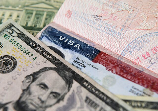US dollar notes and an American visa