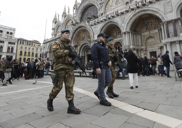 Italian soldiers and policemen patrol St. Mark's Square during the carnival celebrations in Venice, Italy, Saturday, Feb. 11, 2017