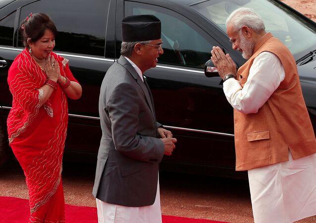 India's Prime Minister Narendra Modi (R) greets Arzu Rana Deuba (L) wife of Nepalese Prime Minister Sher Bahadur Deuba during Deuba's ceremonial reception at the forecourt of India's Rashtrapati Bhavan presidential palace in New Delhi, India, August 24, 2017