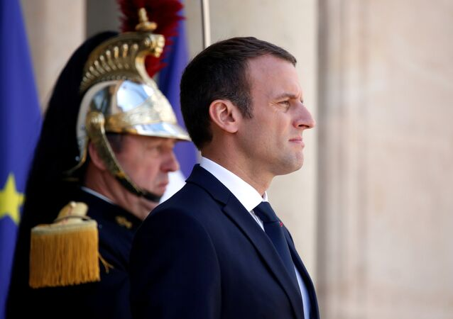 French President Emmanuel Macron stands on the steps of the Elysee Palace in Paris, France, June 16, 2017