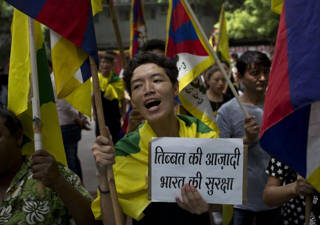 Exile Tibetans shout slogans during a protest to show support with India on Doklam standoff in New Delhi, India, Friday, Aug. 11, 2017