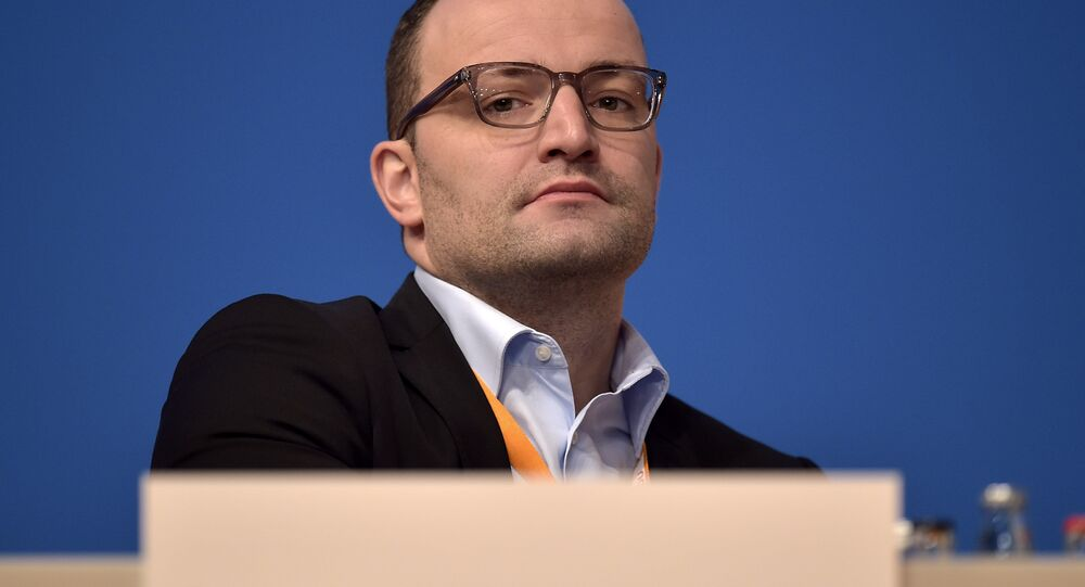 New Deputy Chairman Jens Spahn of the German Christian Democrats, CDU, watches from the podium during the 27th party convention in Cologne, Germany, Wednesday, Dec. 10, 2014.