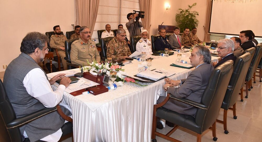 In this photo released by by Pakistan's Press Information Department, Prime Minister Shahid Khaqan Abbasi, left, heads a meeting of the National Security Committee in Islamabad, Pakistan, Thursday, Aug. 24, 2017