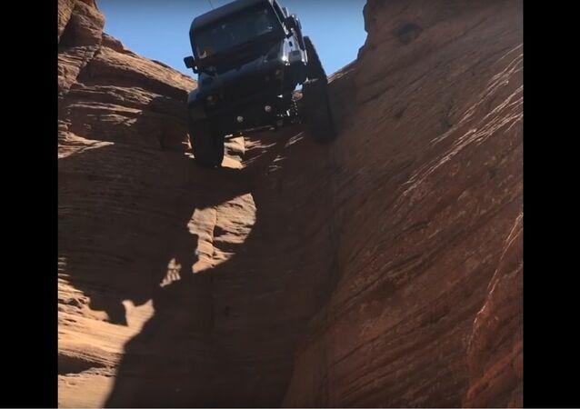 Jeep Drives Down Vertical Chute