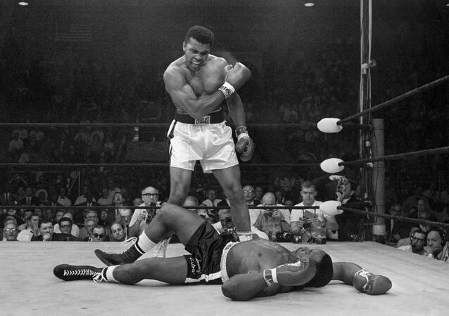 In this May 25, 1965 file photo, heavyweight champion Muhammad Ali stands over fallen challenger Sonny Liston, shouting and gesturing shortly after dropping Liston with a short hard right to the jaw, in Lewiston, Maine. The bout lasted only one minute into the first round. Ali is the only man ever to win the world heavyweight boxing championship three times.