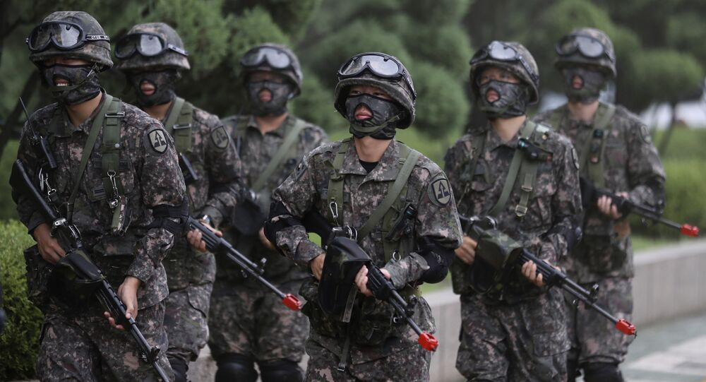 South Korean army soldiers walk after an anti-terror drill as a part of Ulchi Freedom Guardian exercise at National Assembly in Seoul, South Korea, Wednesday, Aug. 23, 2017