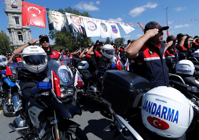 Gendarmerie and police officers salute as Turkish President Tayyip Erdogan (not pictured) arrives at a ceremony in Istanbul, Turkey, August 25, 2017